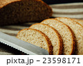 Sliced bread and knife on linen cloth 23598171
