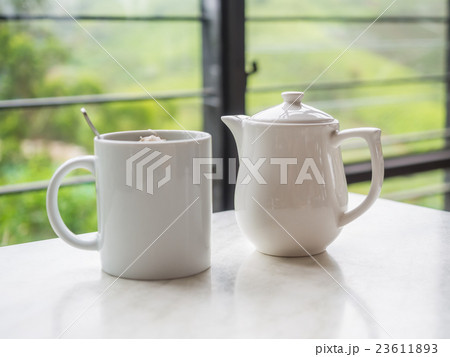 White teapot and tea cup at Boh Tea Plantation 23611893