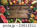 Summer fresh fruit variety with rustic wooden tray 23613311