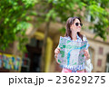 Happy young woman tourist with a city map outdoors 23629275