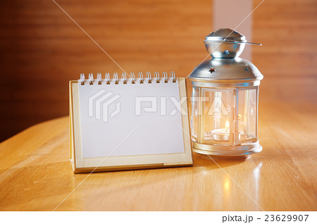candlestick and a notebook for notes on the tableの写真素材 [23629907] - PIXTA