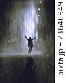 silhouette of man raising arms in the rain at nigh 23646949