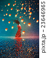 woman and lanterns floating in a night sky 23646965