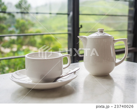 White teapot and tea cup on the table 23740026