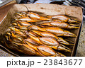 smoked fish in different sizes laying on a table 23843677