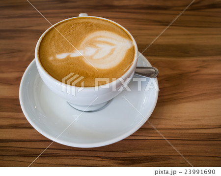 Coffee cup on a wooden table 23991690