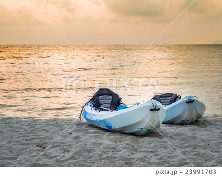 Kayaks on the tropical beach 23991703
