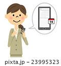 スマートフォンを触るスーツの女性  23995323