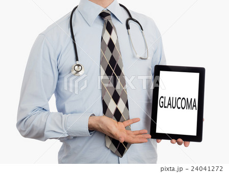 Doctor holding tablet - Glaucomaの写真素材 [24041272] - PIXTA
