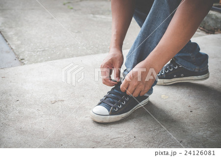 man with sneaker shoes on street ,Traveler in town 24126081