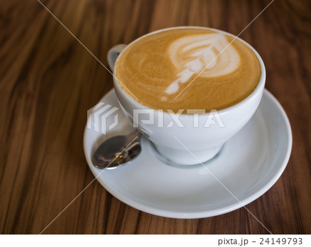 Coffee cup on a wooden table 24149793