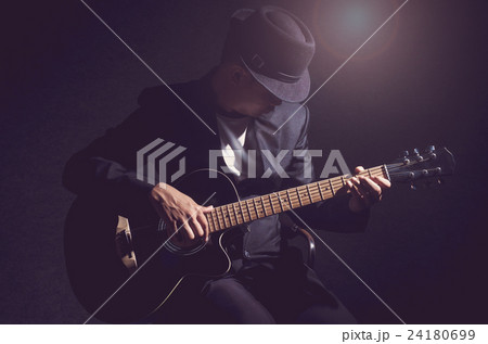Musician playing the guitar on black background,music concept 24180699
