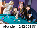 Group of adults playing pool. 24209365