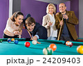 Group of positive friends playing billiards 24209403