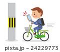 スマホを見ながら自転車を運転し電信柱にぶつかりそうになるビジネスマン 24229773