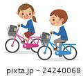 自転車で並走する男女学生 24240068