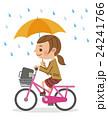 自転車で傘差し運転をする女子生徒 24241766