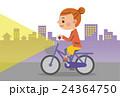 夜間ライトを点灯し自転車を運転する女性(背景あり) 24364750