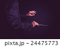 Orchestra conductor hands, Musician director holding stick on dark background 24475773