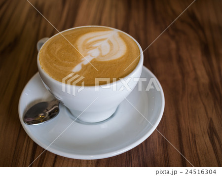 Coffee cup on a wooden table 24516304