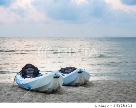Kayaks on the tropical beach 24516313