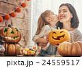 family preparing for Halloween. 24559517