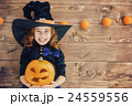 little witch with a pumpkin 24559556