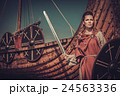 Viking woman with sword and shield standing near 24563336