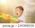 little boy yelling and playing water guns 24599036