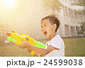 little boy shouting and playing water guns 24599038