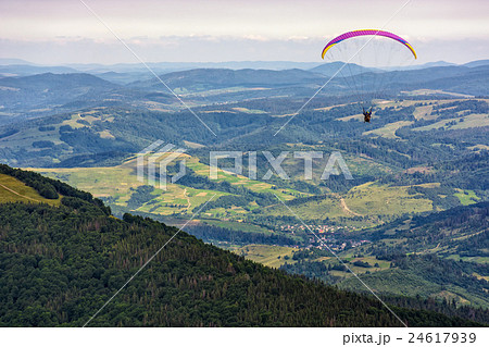 Skydiving  extreme over the mountains 24617939