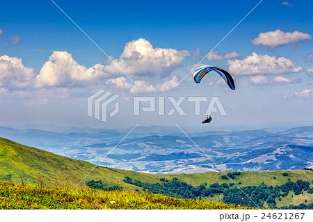 Skydiving  extreme over the mountains 24621267