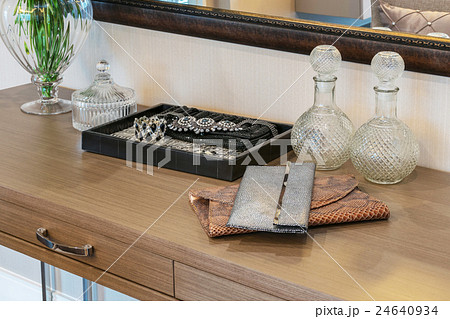 handbag and jewelry set on a dresser tableの写真素材 [24640934] - PIXTA
