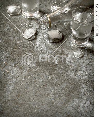 bottle of vodka with glasses and ice.の写真素材 [24644323] - PIXTA