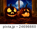 Photo pumpkins on a table with candles   24696660