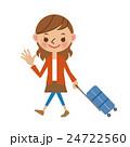 スーツケースを引いて歩く若い女性 24722560