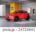 立体駐車場に充電している赤色の電気自動車SUV 24724641