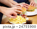 close up of male hands with fast food on table 24755900