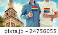 close up of male gay couple with rainbow flags 24756055