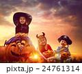 children and pumpkins on Halloween 24761314