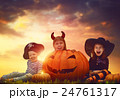 children and pumpkins on Halloween 24761317