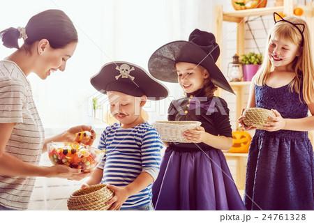 family celebrating Halloween 24761328
