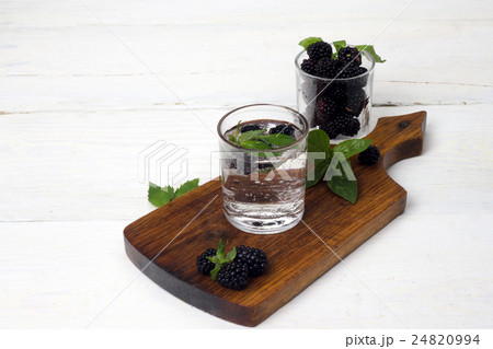 blackberries in a glass on a white backgroundの写真素材 [24820994] - PIXTA
