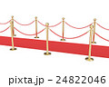 Gold stanchions and a red velvet carpet isolated 24822046