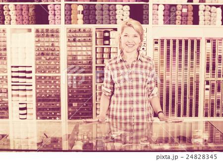 Woman seller standing in sewing storeの写真素材 [24828345] - PIXTA