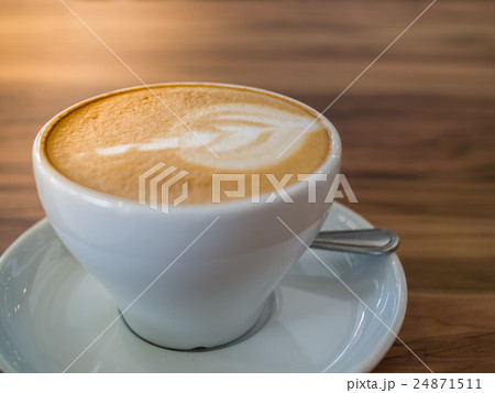 Coffee cup on a wooden table 24871511