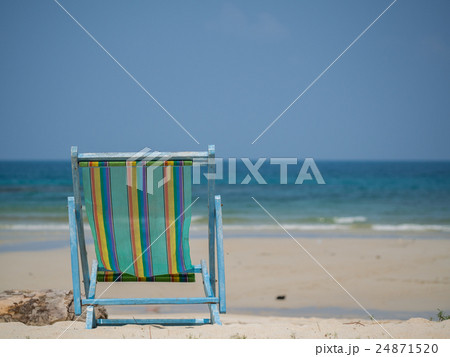 Beach chair on the sand 24871520