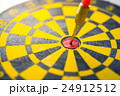 Dart arrow hitting in the target 24912512