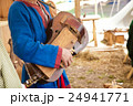 Playing the ancient stringed instrument 24941771