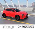 アーチ橋に走行する赤色の電気自動車SUV 24965353